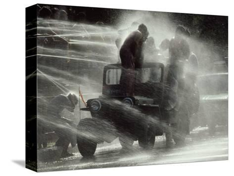 Jeep Full of Innocent Onlookers is Sprayed with Water During the Water Festival-James L^ Stanfield-Stretched Canvas Print