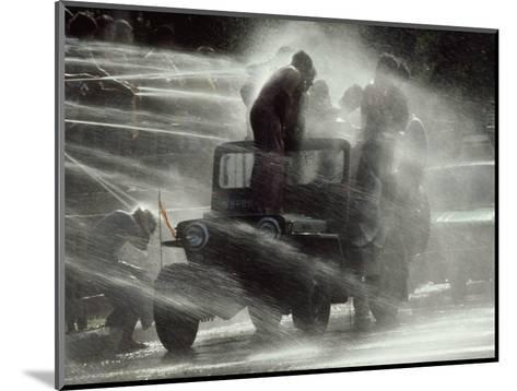 Jeep Full of Innocent Onlookers is Sprayed with Water During the Water Festival-James L^ Stanfield-Mounted Photographic Print
