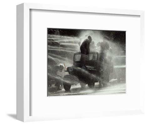 Jeep Full of Innocent Onlookers is Sprayed with Water During the Water Festival-James L^ Stanfield-Framed Art Print