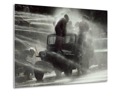 Jeep Full of Innocent Onlookers is Sprayed with Water During the Water Festival-James L^ Stanfield-Metal Print