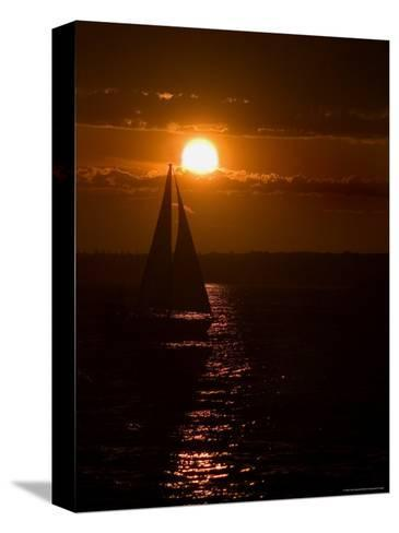 Lone Sailboat Silhouetted by the Setting Sun-Todd Gipstein-Stretched Canvas Print