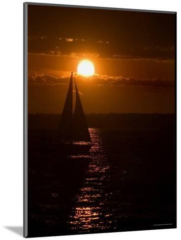 Lone Sailboat Silhouetted by the Setting Sun-Todd Gipstein-Mounted Photographic Print