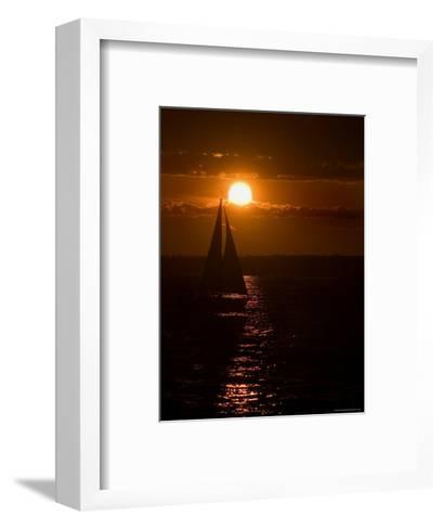 Lone Sailboat Silhouetted by the Setting Sun-Todd Gipstein-Framed Art Print
