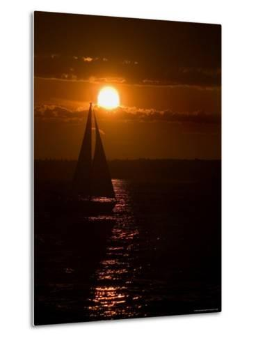 Lone Sailboat Silhouetted by the Setting Sun-Todd Gipstein-Metal Print