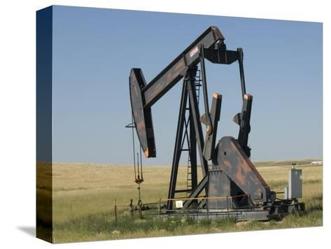 Oil Rig Pumps Oil from the Montana Ground-Joel Sartore-Stretched Canvas Print