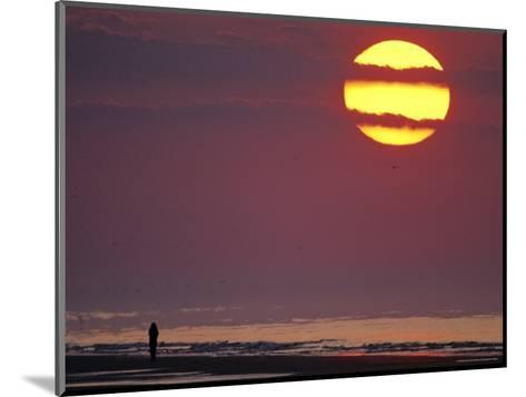 Person Silhouetted on the Beach at Sunrise-Kenneth Garrett-Mounted Photographic Print