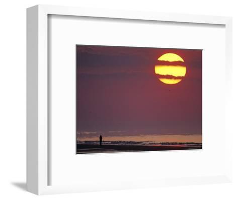 Person Silhouetted on the Beach at Sunrise-Kenneth Garrett-Framed Art Print