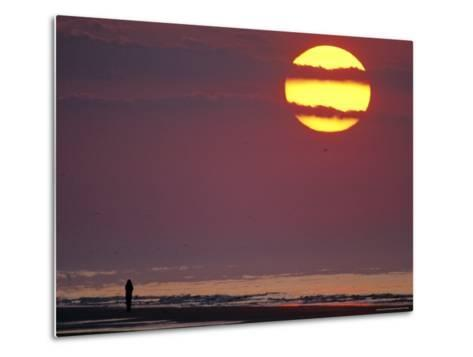 Person Silhouetted on the Beach at Sunrise-Kenneth Garrett-Metal Print