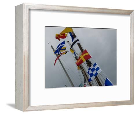 Nautical Flags Hanging from the Wooden Mast of a Sailing Ship ...