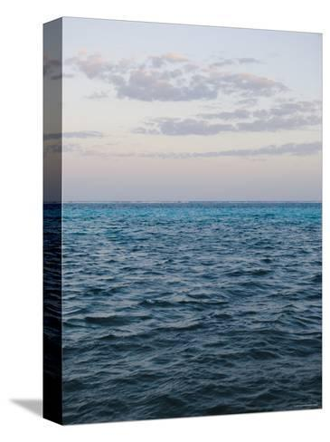 Puffy Clouds on Horizon with Caribbean Turquoise Blue Ocean Foreground, Ambergris Caye, Belize-James Forte-Stretched Canvas Print