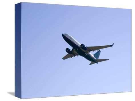Plane Takes Off, Washington, D.C.-Stacy Gold-Stretched Canvas Print