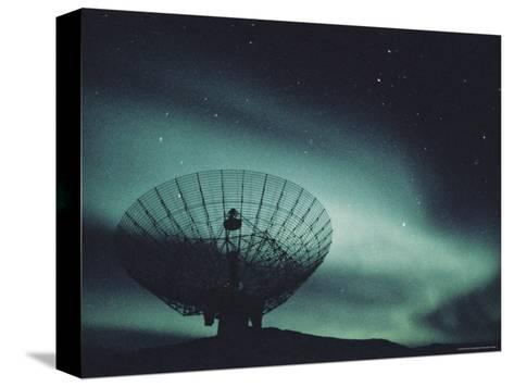 Northern Lights above a Radar Station in Greenland-Kenneth Garrett-Stretched Canvas Print