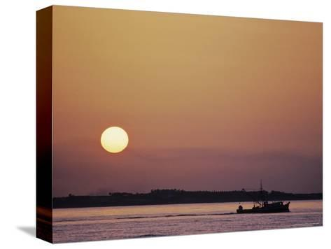 Oyster Boat on the Chesapeake at Sunset-Kenneth Garrett-Stretched Canvas Print