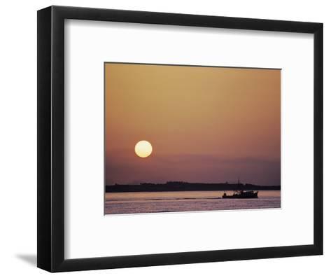 Oyster Boat on the Chesapeake at Sunset-Kenneth Garrett-Framed Art Print