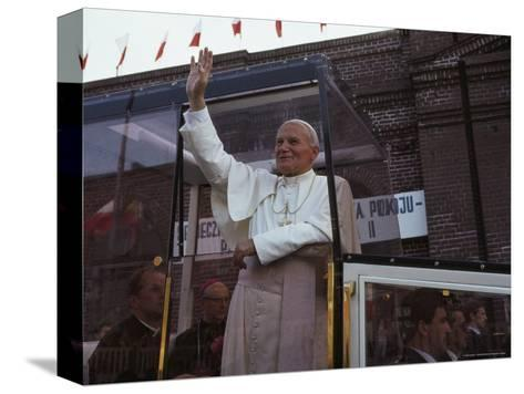 Pope John Paul II Waves from his Bulletproof Vehicle, Warsaw, Poland-James L^ Stanfield-Stretched Canvas Print