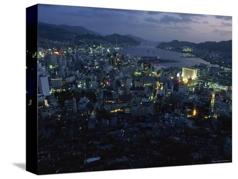 Nagasaki Overlooking its Harbor at Dusk, Japan-James L^ Stanfield-Stretched Canvas Print