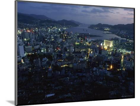 Nagasaki Overlooking its Harbor at Dusk, Japan-James L^ Stanfield-Mounted Photographic Print