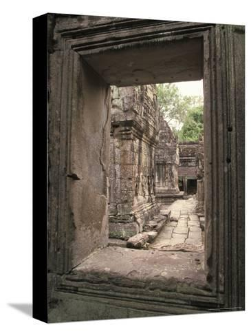Temples of Angkor, Ta Prohm, Cambodia-Richard Nowitz-Stretched Canvas Print