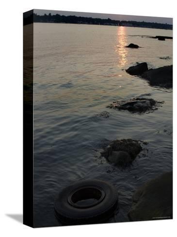 Sunset on the Shore of the Thames River Where a Tire Has Washed Up, Groton, Connecticut-Todd Gipstein-Stretched Canvas Print