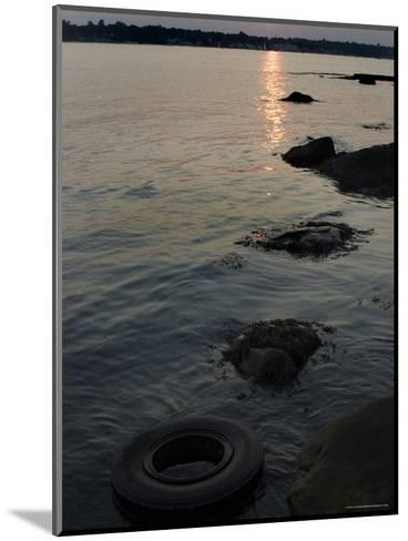 Sunset on the Shore of the Thames River Where a Tire Has Washed Up, Groton, Connecticut-Todd Gipstein-Mounted Photographic Print