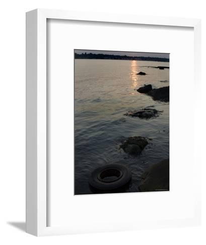 Sunset on the Shore of the Thames River Where a Tire Has Washed Up, Groton, Connecticut-Todd Gipstein-Framed Art Print