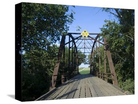 Tall Trees Surround a Wooden Bridge in Eastern Nebraska-Joel Sartore-Stretched Canvas Print
