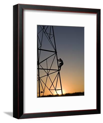Silhouette of a Man Climbing a High Power Electric Line Tower, California-Dawn Kish-Framed Art Print