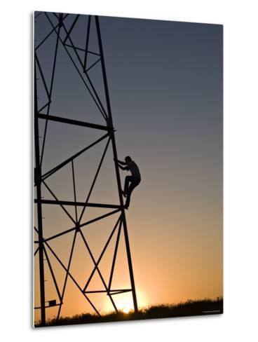 Silhouette of a Man Climbing a High Power Electric Line Tower, California-Dawn Kish-Metal Print