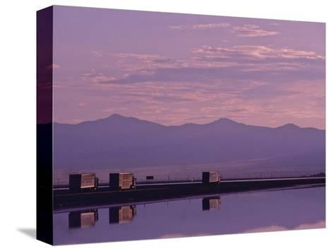Trucks on the Highway Reflected in Great Salt Lake, Utah-Kenneth Garrett-Stretched Canvas Print