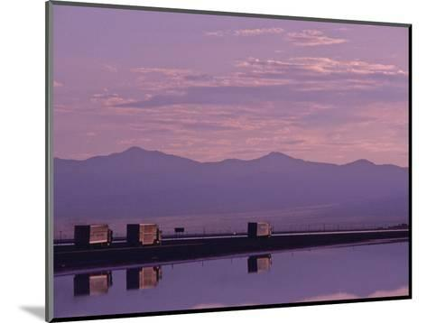 Trucks on the Highway Reflected in Great Salt Lake, Utah-Kenneth Garrett-Mounted Photographic Print