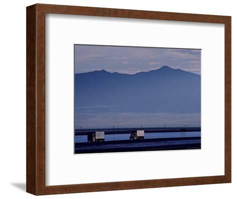 Trucks Along the Highway Next to Great Salt Lake, Utah-Kenneth Garrett-Framed Art Print