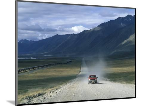Truck on the Dalton Highway Following the Alyeska Pipeline, Alaska-Rich Reid-Mounted Photographic Print