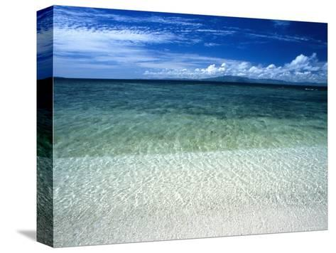Secluded White Sands Beach on a Tropical Island with Blue Sky, Clouds-James Forte-Stretched Canvas Print