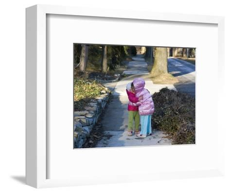Sisters Show their Love in a Big Greeting Hug-Stacy Gold-Framed Art Print