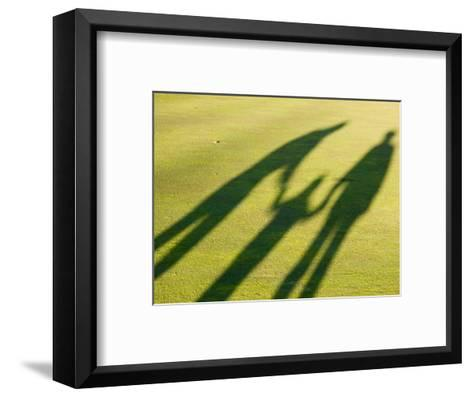 Tall Shadows Loom on the Greens of a Golf Course-Stacy Gold-Framed Art Print