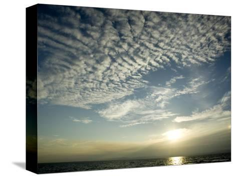 Setting Sun over the Sea with Cloud Filled Sky, Belize-Tim Laman-Stretched Canvas Print