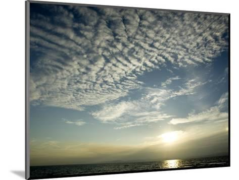Setting Sun over the Sea with Cloud Filled Sky, Belize-Tim Laman-Mounted Photographic Print