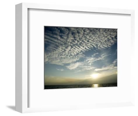Setting Sun over the Sea with Cloud Filled Sky, Belize-Tim Laman-Framed Art Print