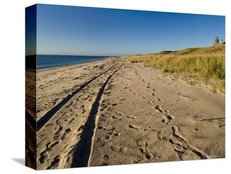 Tire Tracks and Footprints in the Sand Along a Beach by a Lighthouse, Block Island, Rhode Island-Todd Gipstein-Stretched Canvas Print