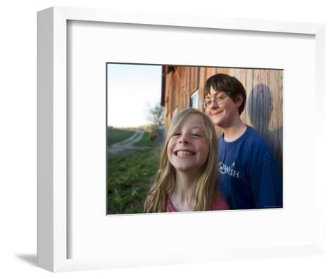 Two Siblings Play near an Old Barn in Nebraska-Joel Sartore-Framed Art Print