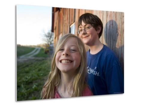 Two Siblings Play near an Old Barn in Nebraska-Joel Sartore-Metal Print