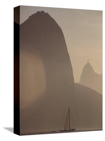 Sugar Loaf Mountain Towers above a Sailboat on Guanabara Bay-Stephanie Maze-Stretched Canvas Print