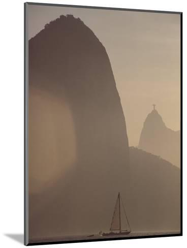 Sugar Loaf Mountain Towers above a Sailboat on Guanabara Bay-Stephanie Maze-Mounted Photographic Print