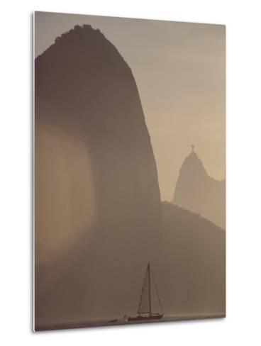 Sugar Loaf Mountain Towers above a Sailboat on Guanabara Bay-Stephanie Maze-Metal Print