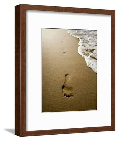 Waves About to Wash over Footprints in the Sand, Anaho Bay, French Polynesia-Tim Laman-Framed Art Print