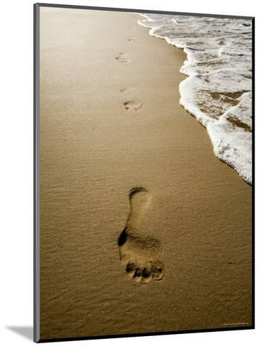 Waves About to Wash over Footprints in the Sand, Anaho Bay, French Polynesia-Tim Laman-Mounted Photographic Print