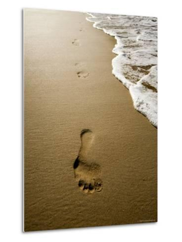 Waves About to Wash over Footprints in the Sand, Anaho Bay, French Polynesia-Tim Laman-Metal Print