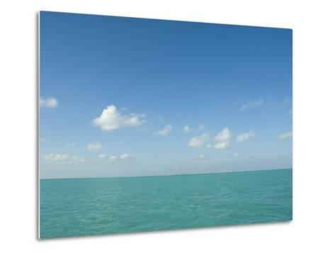 White Puffy Clouds above Turquoise Blue Caribbean Water, Ambergris Caye, Belize-James Forte-Metal Print