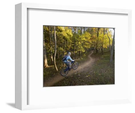 Woman Mountain Biker Rides Singletrack Trail Through Woods-Skip Brown-Framed Art Print