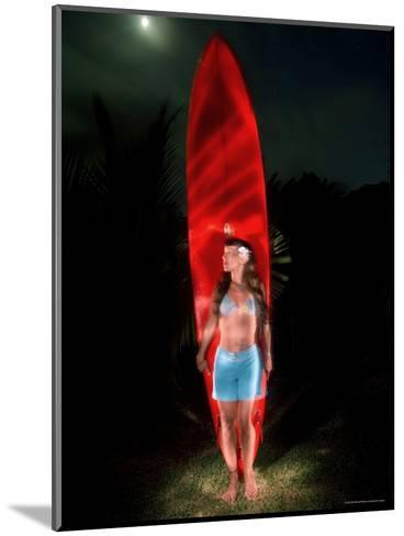 Woman Stands by a Big Wave Surf Board under a Full Moon, Hawaii-Bill Hatcher-Mounted Photographic Print